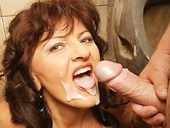 Horny mature slut caught on a public toilet