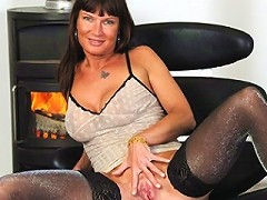 Naughty MILF playing by the fire place