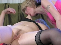 Insatiable mom gets down with a girl