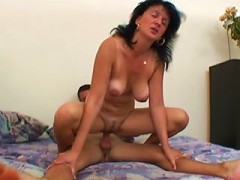 Lucky boy lets a sexy old brunette handle his dick