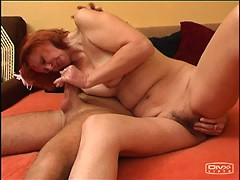 Red-haired mommy takes a long dick down her throat